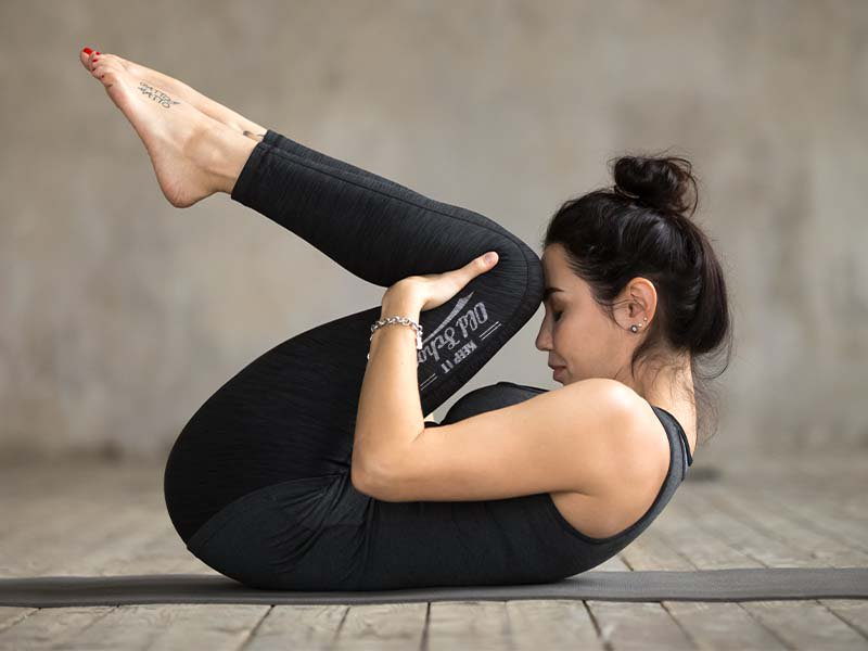 knees to chest yoga pose