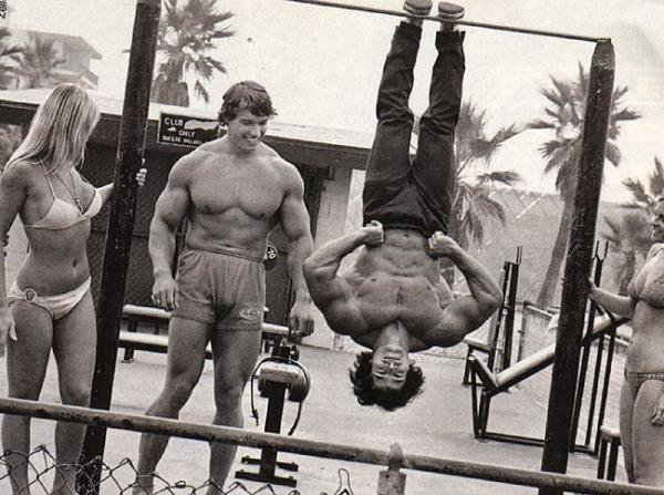 Franco Columbu working out at the beach