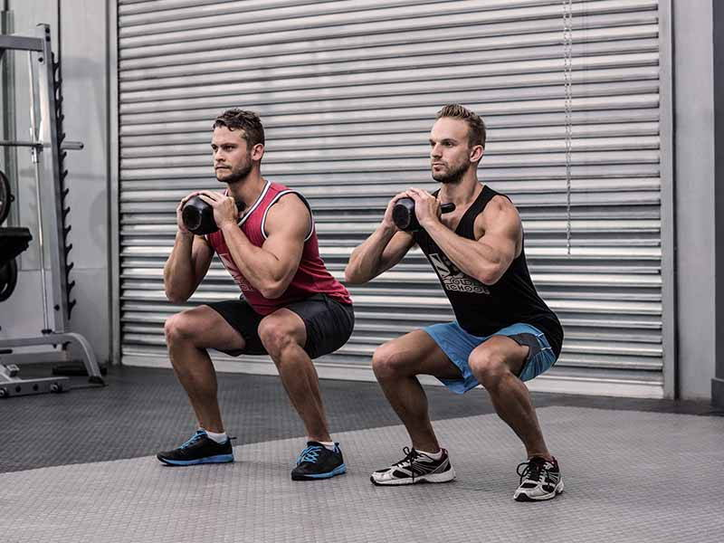 Squats with Kettle Bell