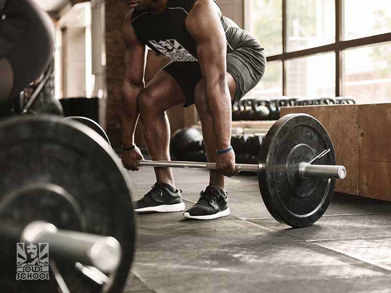 Man Dead-lifting barbell