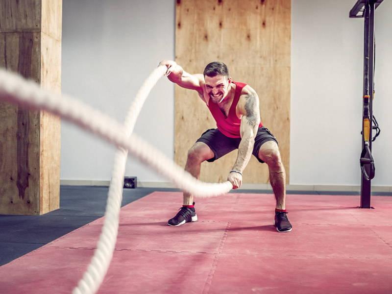 Man Lifting Ropes