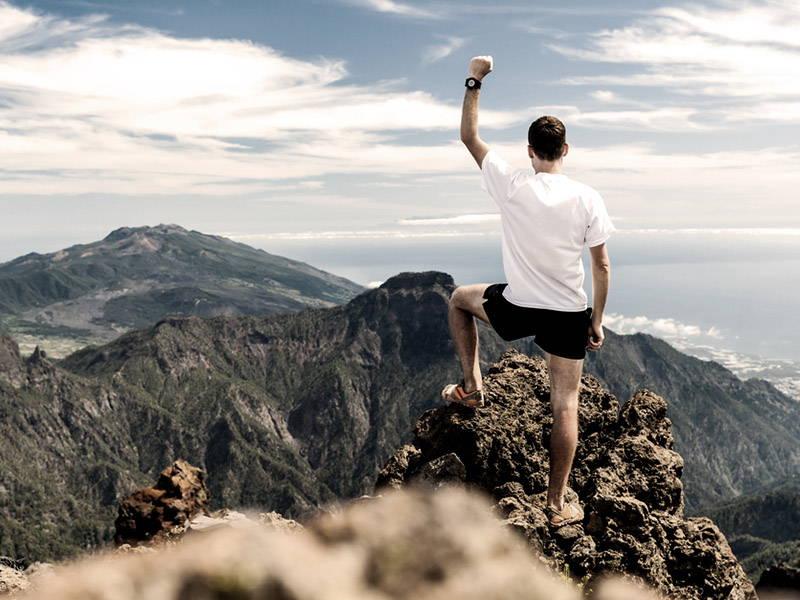Man Celebrating Completing Hike