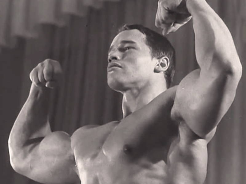 Arnold Flexing