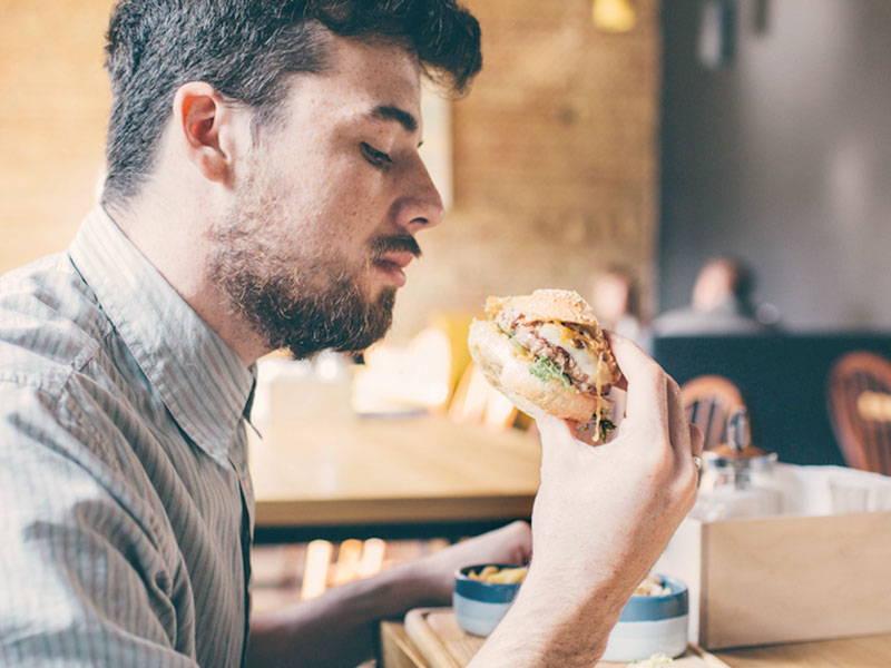 Man Eating Burger